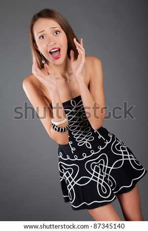 young woman in studio emotion portrait - stock photo