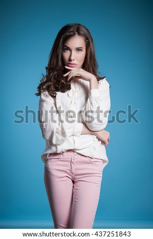 Young woman in stylish clothing, studio picture. Fashionable woman in stylish clothes, studio, background blue - stock photo