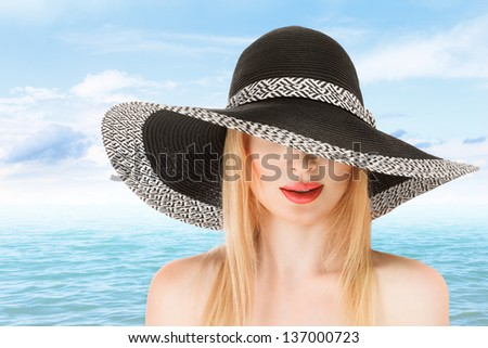 Young woman in sunhat at beach sunny day outdoor - stock photo