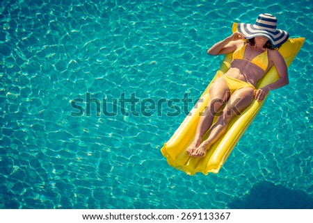 Young woman in swimming pool. Summer vacation concept. Top view portrait - stock photo
