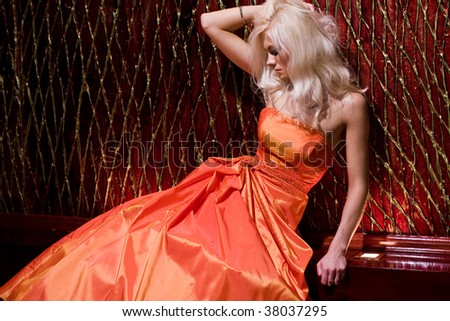 Young woman in the beautiful interior - stock photo
