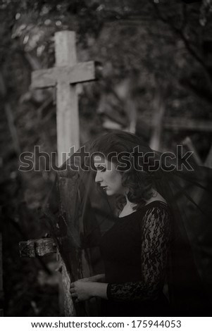 Young woman in the cemetery - stock photo