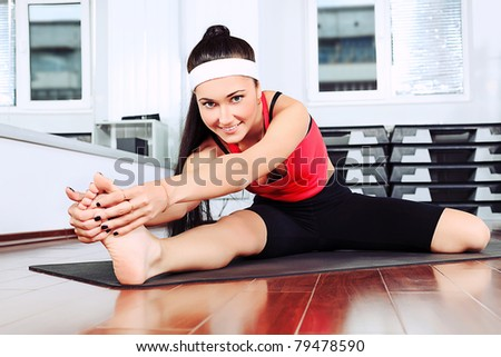 Young woman in the gym centre. - stock photo