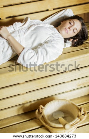 Young woman in the sauna - stock photo