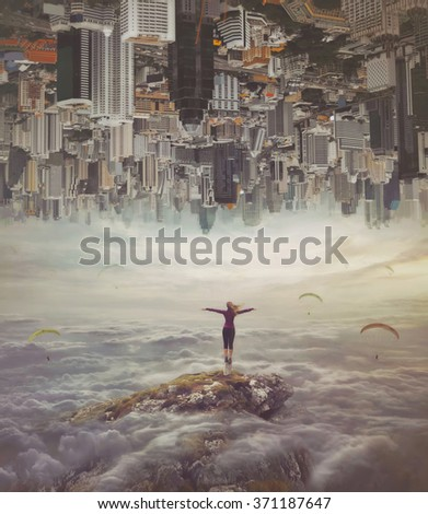 Young woman in the sky standing on a rock with divorced hands - stock photo