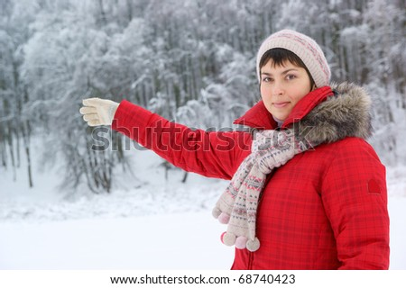 Young woman in the winter forest - stock photo