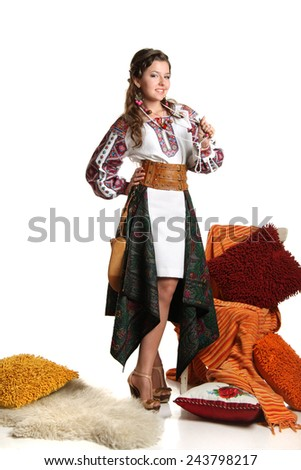young woman in Ukrainian costume on a white background. with elements of Ukrainian themes. beautiful hair and makeup - stock photo
