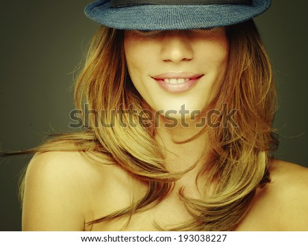 Young woman in vintage hat - stock photo