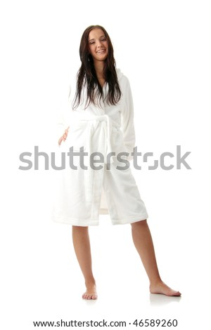 Young woman in white bathtub isolated on white background - stock photo