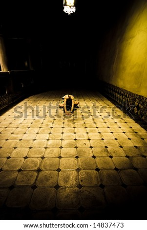 Young woman in white drees on the floor - stock photo
