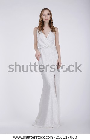 Young Woman in White Evening Dress - stock photo