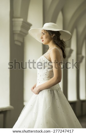 Young woman in white long dress and hat. Mid Shot. MS - stock photo