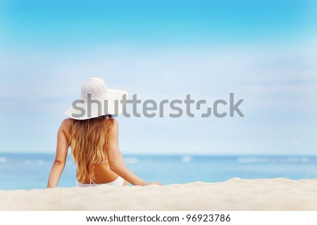 young woman in white swimsuit on the beach, bali - stock photo