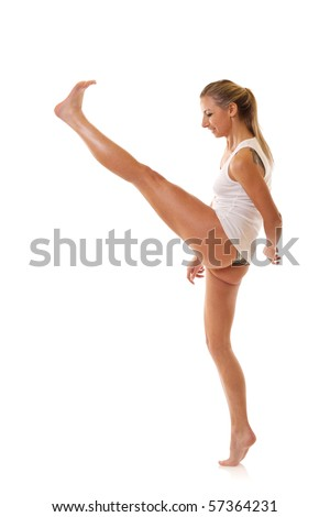 Young woman in white underwear kicking, on white background - stock photo
