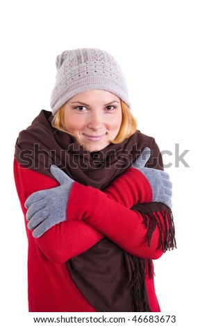 Young woman in winter clothes trying to warm up. - stock photo