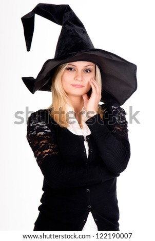 young woman in witch costume - stock photo