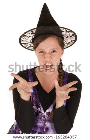 young woman in witch's hat funny expression - stock photo