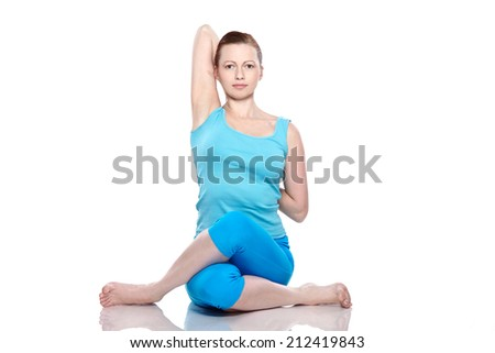 Young woman in yoga posture - stock photo