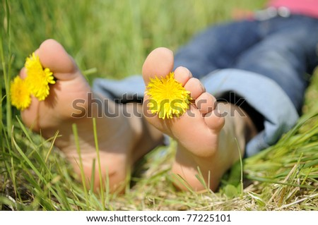 young woman is barefoot in a meadow - stock photo