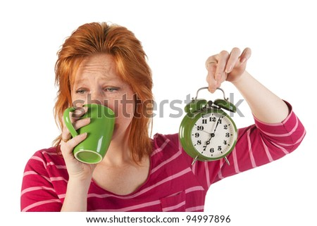 Young woman is enjoying het morning coffee while wake up very early - stock photo