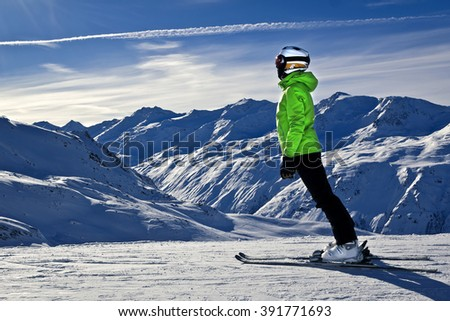 young woman is enjoying winter sports in Austrian Alps - stock photo
