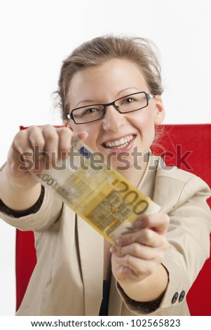 Young woman is happy about hundred euros - stock photo