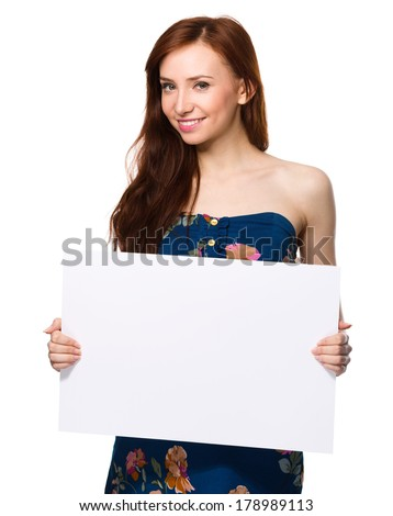 Young woman is holding blank banner, isolated over white - stock photo