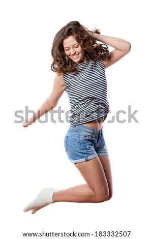 Young woman is jumping. Isolated on white background. Studio shot - stock photo