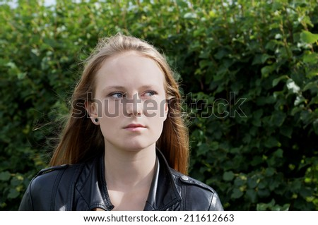young woman is lost in thought - stock photo