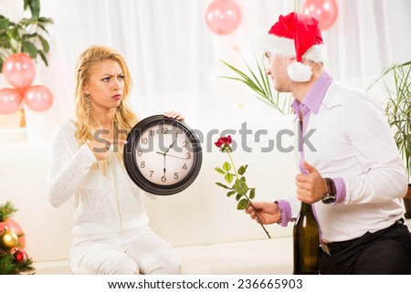 Young woman is mad at her boyfriend who missed the New Year party. - stock photo