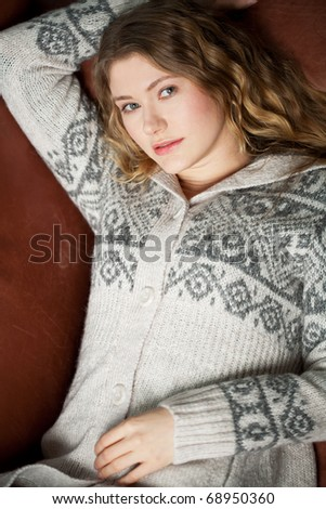 young woman is relaxing on the couch - stock photo