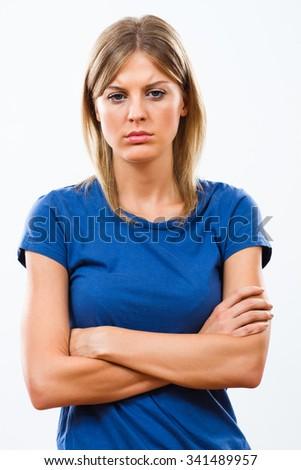 Young woman is sad because of something.Sad woman - stock photo