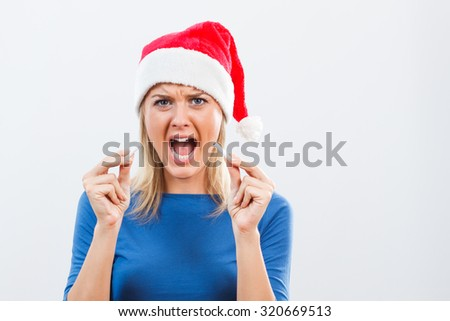 Young woman is very angry because of her addiction to cigarettes and she decided to start a new life without cigarettes in the new year.New Year's stop smoking resolution - stock photo