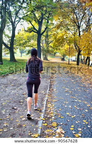 young woman jogging in the park - stock photo