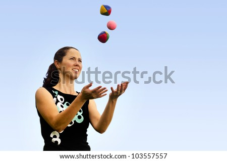 Young woman juggler is juggling balls.concept photo of flexibility, success, skill and control.  - stock photo