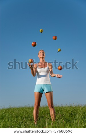 young woman juggling with healthy eating - stock photo