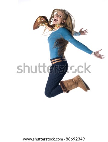 young woman jumping against white background - stock photo