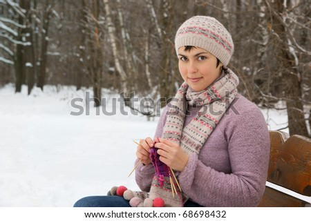 Young woman knitting outdoor - stock photo