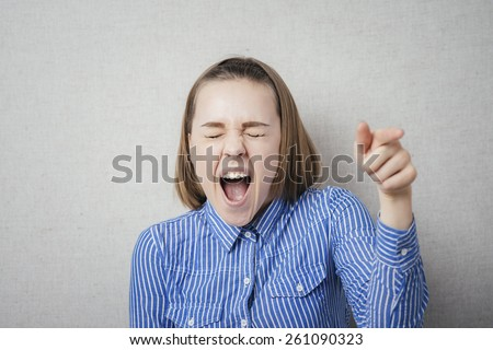 young woman laughing with someone - stock photo