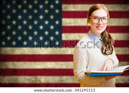 Young woman learning English - stock photo