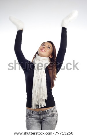 young woman lift the hands with wollen mitten in scarf and sweater - stock photo