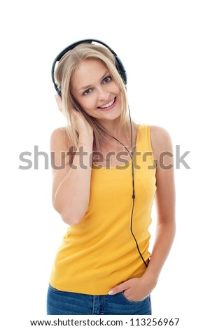 young woman listen to music, isolated on white background - stock photo