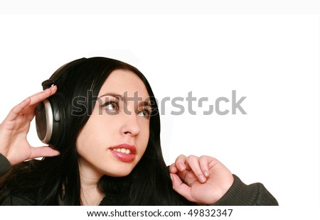 young woman listening music in headphones - stock photo