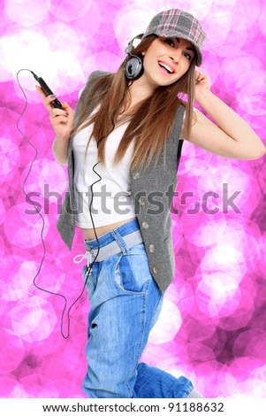 young woman listening music with bokeh effect on background - stock photo