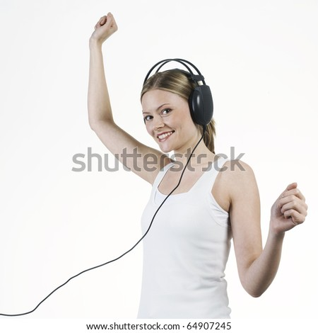 young woman listening music with headphones - stock photo