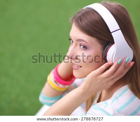 Young woman listening to the music . - stock photo