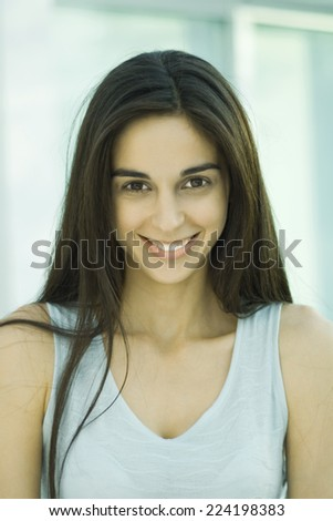 Young woman, looking at camera, head and shoulders, front view, portrait - stock photo