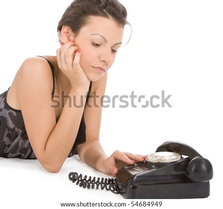 young woman looking at old phone waiting for a call - stock photo