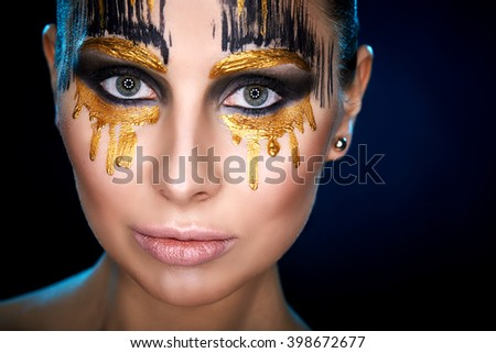 Young woman looking at the camera with fantasy make up face art studio shot. Copy space. High resolution  - stock photo