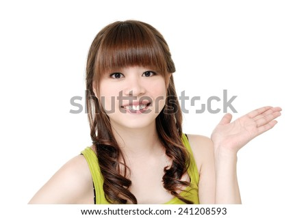 Young woman looking at your product with great joy - stock photo